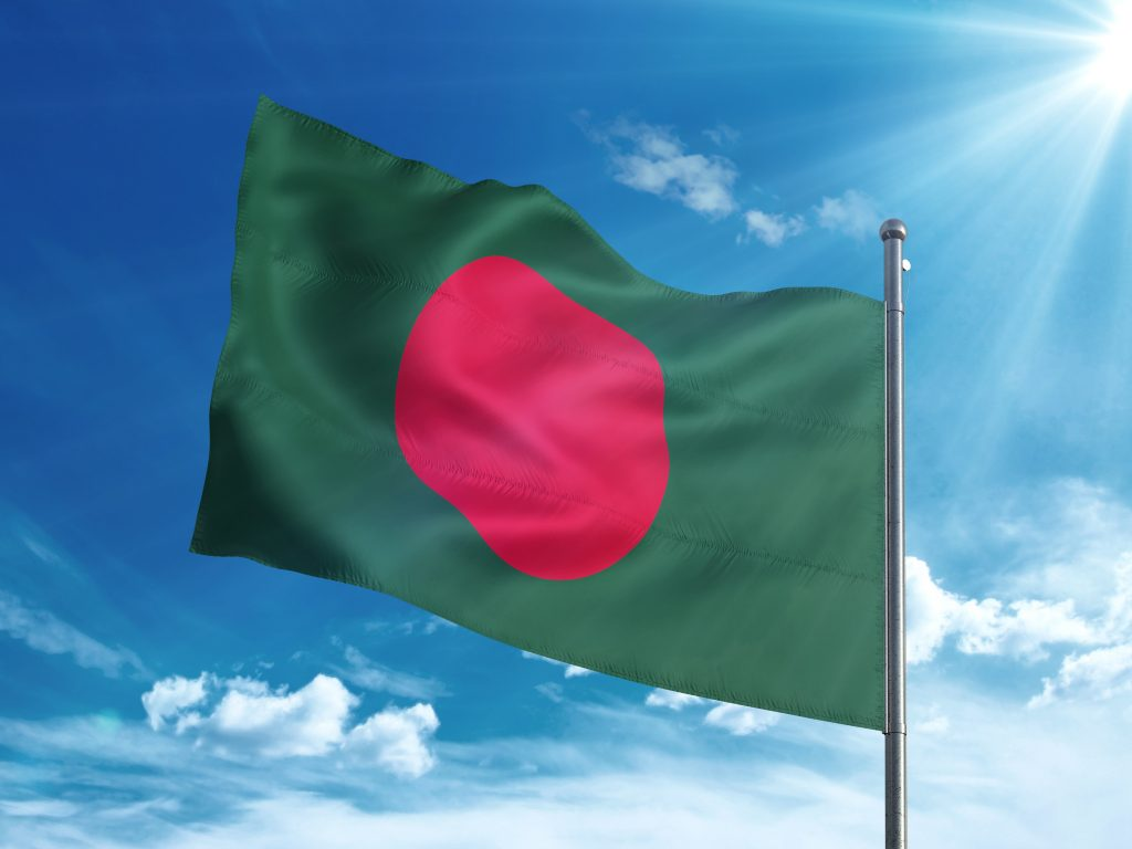 Bangladeshi flag waving in the blue sky